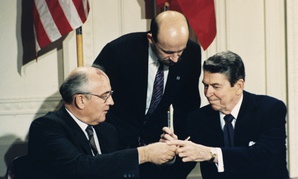 President Ronald Reagan, right, and Soviet leader Mikhail Gorbachev trade pens after signing the INF in 1987.