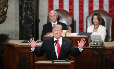 President Donald Trump delivers his State of the Union address to a joint session of Congress on Capitol Hill in Washington, as Vice President Mike Pence and Speaker of the House Nancy Pelosi look on.