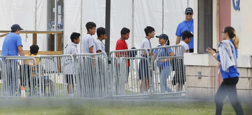 Immigrant children line up in June outside the Homestead Temporary Shelter for Unaccompanied Children.