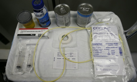 Nutritional shakes, a tube for feeding through the nose, and lubricants, including a jar of olive oil, are displayed as force feeding is explained during a tour of the detainee hospital at Guantanamo Bay Naval Base, Cuba in 2013.