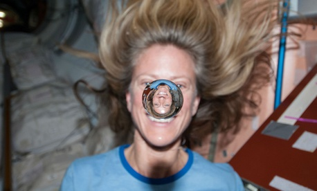 NASA astronaut Karen Nyberg poses with a water bubble on the International Space Station
