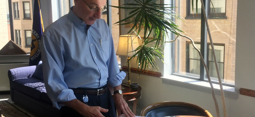 Mark Robbins, the last remaining MSPB member, looks through cases in his office in August. His term expires March 1.