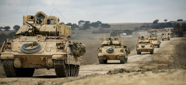Bradley Fighting Vehicles convoy towards their battle positions during the combined arms live-fire exercise Feb. 9.