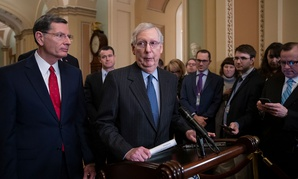 Senate Majority Leader Mitch McConnell, R-Ky., joined from left by Sen. John Barrasso, R-Wyo., and Sen. Todd Young, R-Ind., speaks to reporters in January at the Capitol.