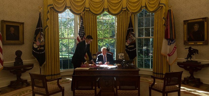 Trump works in the Oval Office in 2017