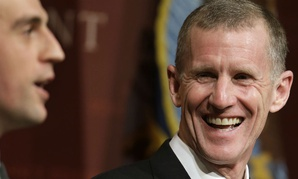 Retired U.S. Army Gen. Stanley McChrystal, right, reacts to moderator Daniel Feehan, left, at a forum at Harvard University in 2013.