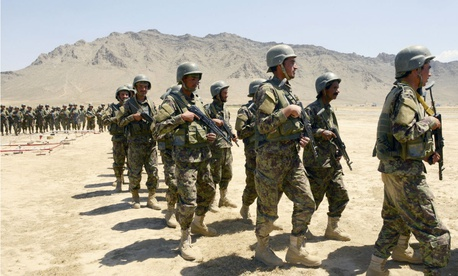 Afghan National Army-Territorial Force members prepare for an exercise at the Kabul Military Training Center in Kabul, Afghanistan, last June.