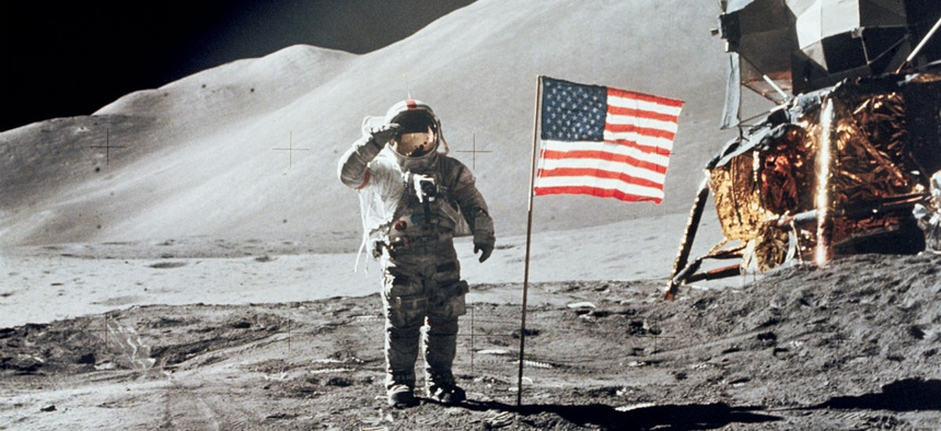 Astronaut David R. Scott, commander, gives a military salute while standing beside the deployed United States flag during the Apollo 15 lunar surface extravehicular activity in 1971.