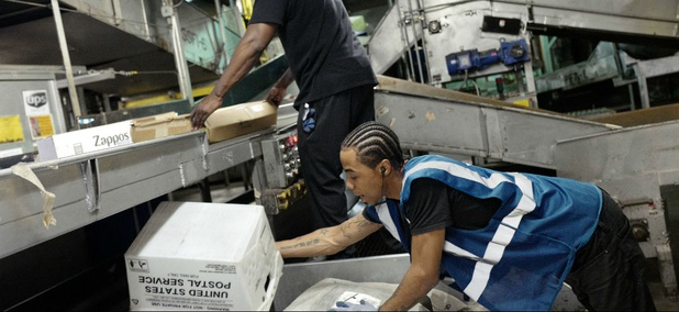 UPS employees sort packages on a conveyor belt at a company facility, Tuesday, May 9, 2017 in New York.