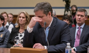 Michael Cohen, President Donald Trump's former personal lawyer, becomes emotional as he finishes a day of testimony to the House Oversight and Reform Committee on Wednesday.