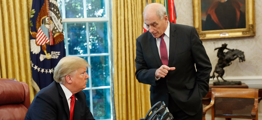 President Donald Trump listens to White House Chief of Staff John Kelly in the Oval Office in 2018.