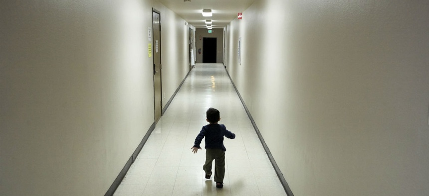 An asylum-seeking boy from Central America runs down a hallway in a San Diego shelter, after arriving from an immigration detention center.