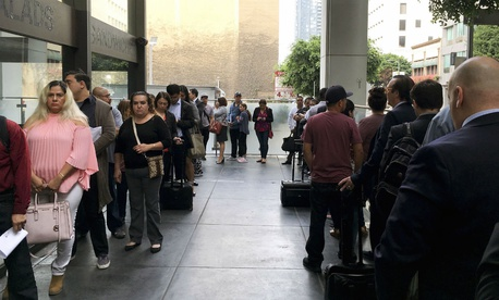 Immigrants awaiting deportation hearings line up outside federal court in Los Angeles. President Trump's budget would fund more immigration judges to help handle the backlog of cases.