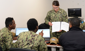 Electronics Technician 2nd Class Makayla Burgan, Security Plus Lead Instructor teaches fleet students VMWare software applications for the shipboard Consolidated Afloat Network Enterprise Services (CANES) system.