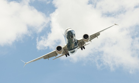 A Boeing 737 Max flies in the United Kingdom in July.