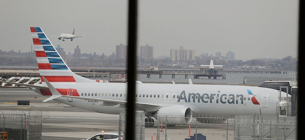 An American Airlines Boeing 737 MAX 8 sits at a boarding gate at LaGuardia Airport Wednesday.