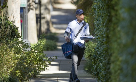 A USPS letter carrier makes the rounds in Washington in 2018.