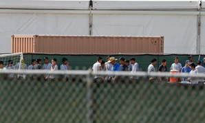 Migrant children walk outside at the Homestead Temporary Shelter for Unaccompanied Children  in 2018 in Florida.