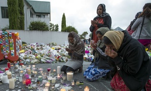 People mourn at a makeshift memorial site near the Al Noor mosque in Christchurch, New Zealand, March 19.