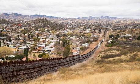 Layers of Concertina are added to existing barrier infrastructure along the U.S. - Mexico border near Nogales, Arizona in February.