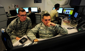 U.S. Air Force cyber security technicians with the 355th Communications Squadron review work orders at Davis-Monthan Air Force Base Ariz. in September.