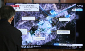 A man watches a TV screen showing an image of the Sohae Satellite Launching Station in Tongchang-ri, North Korea, during a news program at the Seoul Railway Station in Seoul, South Korea, Wednesday, March 6, 2019.