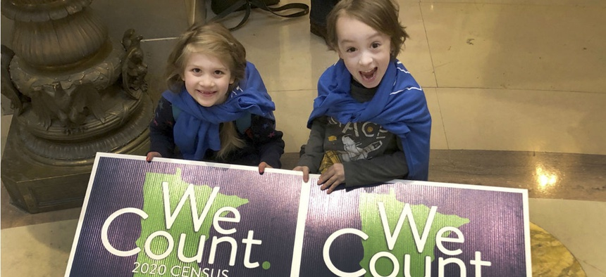 Noelle Fries, 6, left, and Galen Biel, 6, both of Minneapolis, attend a rally at the Minnesota Capitol on Monday, April 1, 2019, to kick off a year-long drive to try to ensure that all Minnesota residents are counted in the 2020 census.