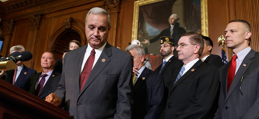 Rep. Jeff Miller (foreground), R-Fla., is shown after calling for reforms in the wake of gross mismanagement and misconduct at VA hospitals in May 2014.
