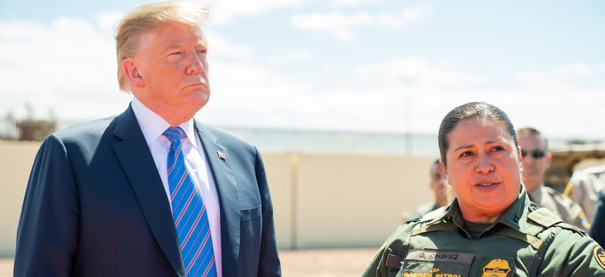 President Donald J. Trump , meeting with reporters, speaks with Gloria Chavez, the Chief Patrol Agent, El Centro Sector for U.S. Customs and Border Protection on April 5.