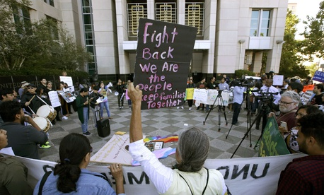 Protesters demonstrate outside the federal courthouse in Sacramento, Calif., in June 2018 where a judge heard arguments over the U.S. Justice Department's request to block three California laws that extend protections to people in the country illegally.
