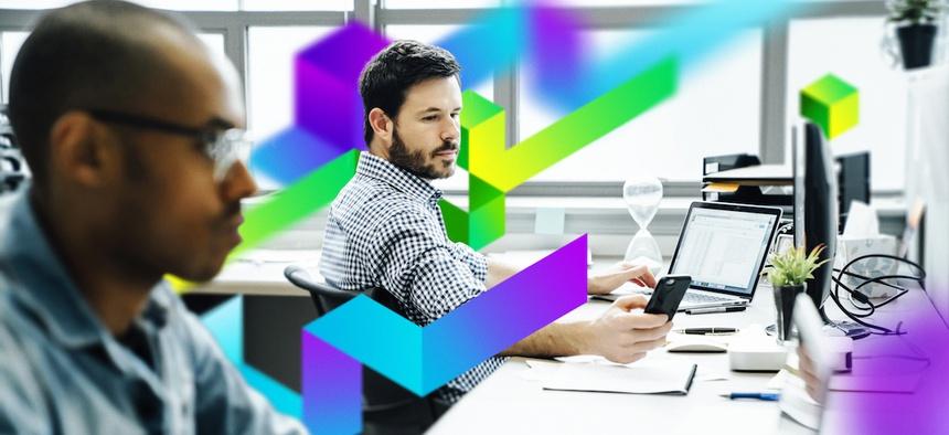 Businessmen using technology in office