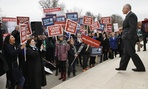Supporters of Illinois government employee Mark Janus cheer as he walks to thank them, outside the Supreme Court, Monday, Feb. 26, 2018, in Washington. New legal disputes have arisen in the wake of the Supreme Court's decision in the case last year.