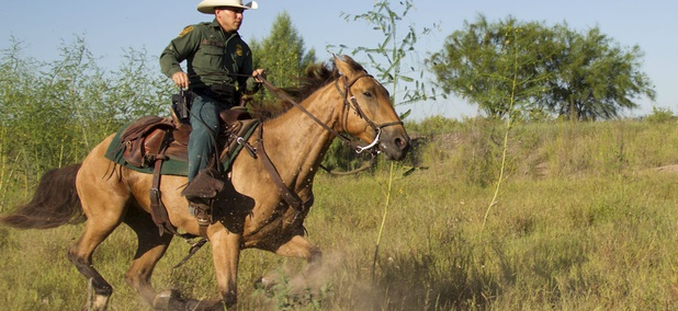A Border Patrol agent from the McAllen station patrols on horseback in South Texas.