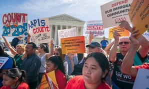 Immigration activists rally outside the Supreme Court on Tuesday.