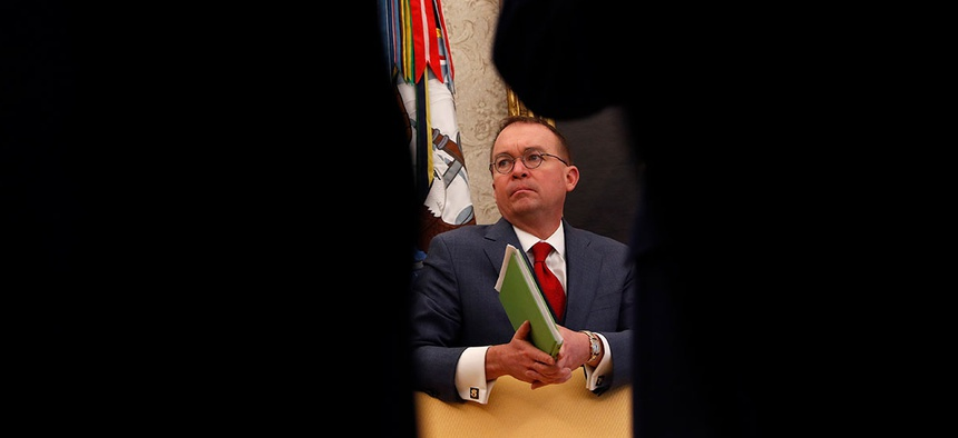 Mulvaney listens to Trump speak at the White House in January.