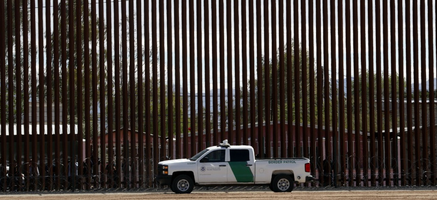 A U.S. Customs and Border Protection vehicle sits near the a new section of the border wall with Mexico in Calexico.