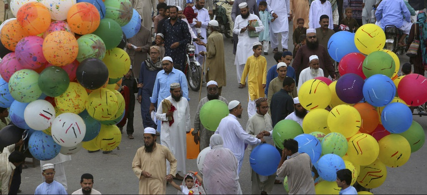 Pakistani people leave after offering Eid al-Fitr prayers to celebrate the end of the holy month of Ramadan in Karachi last year.