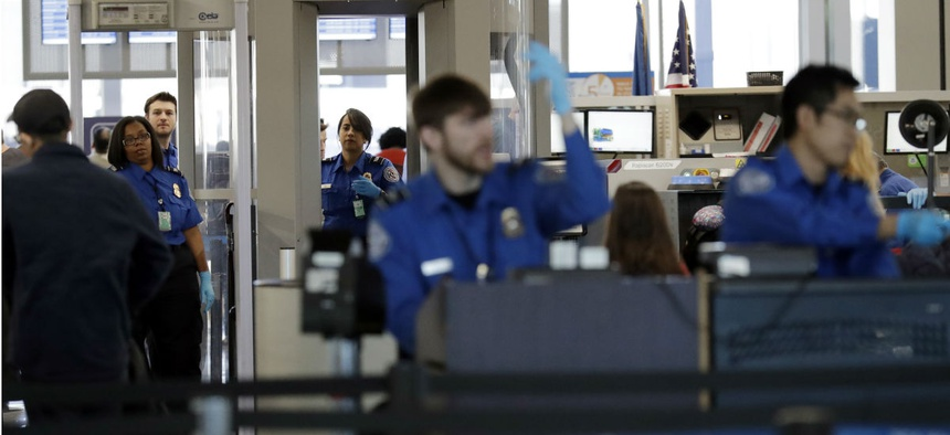 TSA screeners work a checkpoint at Chicago's O'Hare International Airport in January.