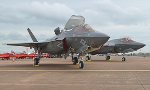 A Marine Corps F-35B sits in front of a US Air Force F-25A at the 2016 Royal International Air Tattoo, Fairford, UK.