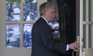 National Security Adviser John Bolton enters the West Wing of the White House, Friday, May 3, 2019, in Washington.