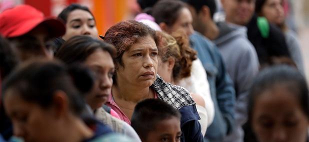 Asylum seekers, lining up in Tijuana in 2018.