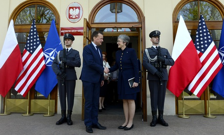 Air Force Secretary Heather Wilson greets Polish Defense Minister Mariusz Blaszczak in Warsaw.