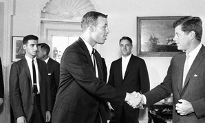 John Kennedy shakes hands with one of the first Peace Corps volunteers in 1961
