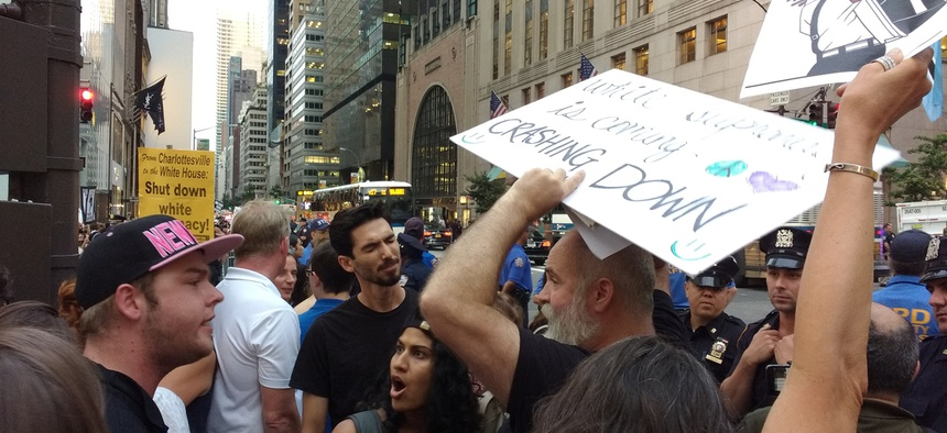 Rally attendees argue in New York in 2018 before Donald Trump's arrival at Trump Tower.