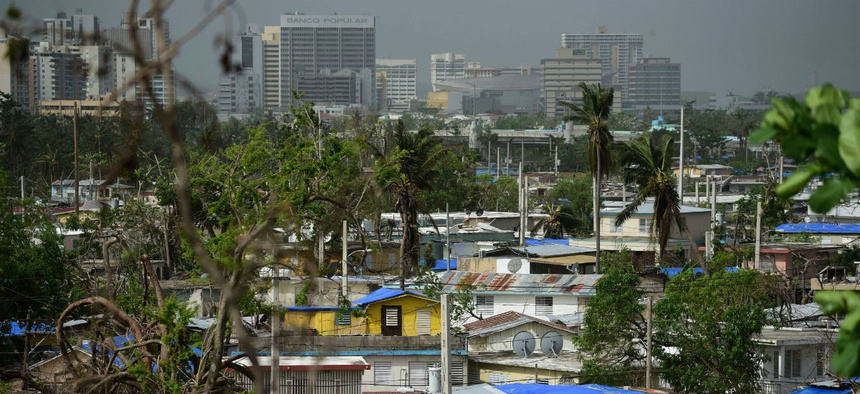 Homes in Puerto Rico stand covered with FEMA tarps in October 2017 after Hurricane Maria.