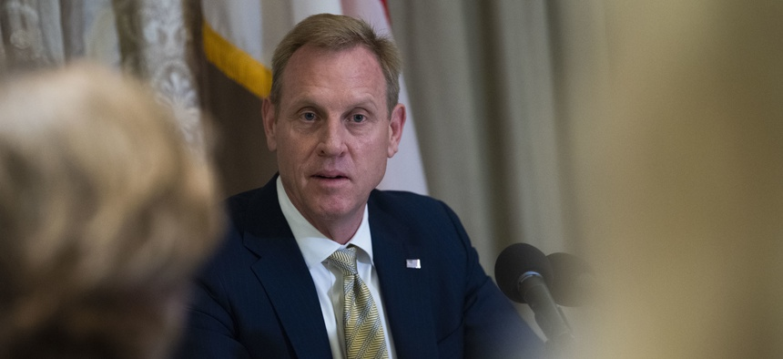 U.S. Acting Secretary of Defense Patrick M. Shanahan speaks with reporters at the IISS Shangri-La Dialogue 2019, Singapore, May 31, 2019.