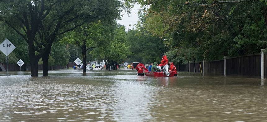 A Coast Guard Flood Punt Team transports a family across a flooded neighborhood in Houston in 2017.
