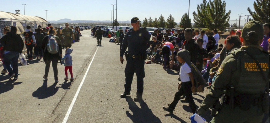 This May 29, 2019 photo released by U.S. Customs and Border Protection shows some of 1,036 migrants who crossed the U.S.-Mexico border in El Paso, Texas, the largest group that the Border Patrol says it has ever encountered.