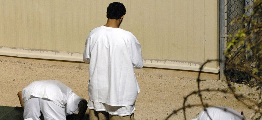 Detainees at Guantanamo participate in morning prayer before sunrise inside Camp Delta in 2010.