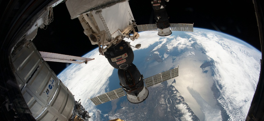 e Northrop Grumman Cygnus space freighter, the Soyuz MS-12 crew ship and the Progress 72 cargo craft are pictured attached to the International Space Station as the orbiting complex flew 258 miles above the Gulf of St. Lawrence.
